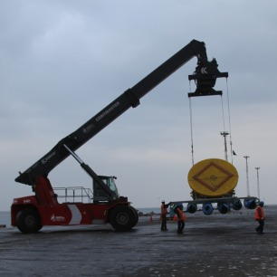 Using this common container stacker, we're able to lower and retrieve our equipment from the ocean.